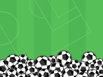 Soccer balls background. Soccer balls border on green background for copy space Royalty Free Stock Photo