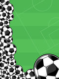 Soccer balls border. On green background for copy space Royalty Free Stock Photo