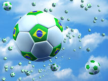Soccer balls with Brazilian flag. Soccer balls on the air with Brazilian flag on the air Royalty Free Stock Photo