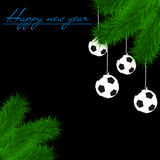 Soccer balls on Christmas tree branch. Congratulations to the New Year and soccer balls hanging on the Christmas tree branch on a black background. Vector Stock Photography