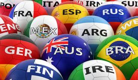 Soccer balls colored in different national flag colors Royalty Free Stock Images