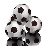 Soccer balls. Composed of a pyramid, four, white background, under them is a reflection Royalty Free Stock Images