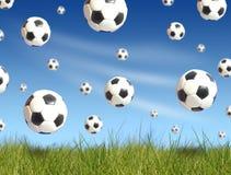 Soccer balls falling. Blue sky on background Stock Images