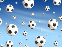 Soccer balls falling. Blue sky on background Stock Photography
