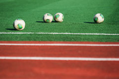 Soccer balls on the field. Football in Russia Royalty Free Stock Images