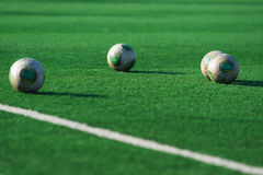 Soccer balls on the field Royalty Free Stock Image