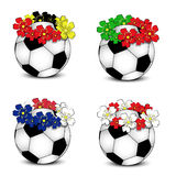 Soccer balls with floral national flags Royalty Free Stock Images