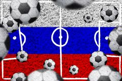 Russian flag with soccer balls. Soccer balls on a football grass textured Russian flag stock image