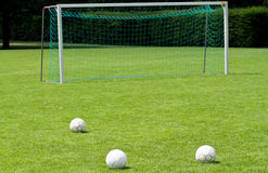 Soccer balls in front of goal Royalty Free Stock Image