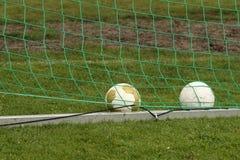 Soccer balls in goal Royalty Free Stock Photos