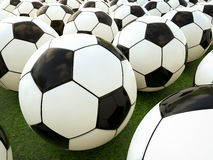 Soccer balls on green field Stock Photo
