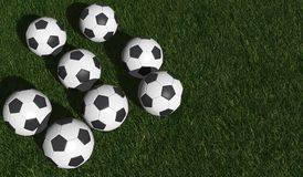Soccer balls on a green grass Royalty Free Stock Photography