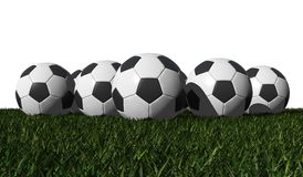 Soccer balls on a green grass Royalty Free Stock Photo