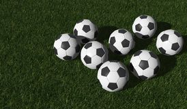 Soccer balls on a green lawn Stock Photo