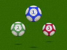 Soccer Balls Hovering Over Green Field. Soccer Balls With Numbers One, Two and Three - 3D Illustration (balls have clipping paths Stock Photography
