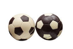 Soccer balls made of white and milk chocolate Royalty Free Stock Images