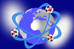 Soccer balls that revolve around earth globe Royalty Free Stock Images