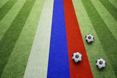 Soccer balls and russia flag on the field Stock Photo