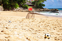 Soccer balls on sand Stock Photo