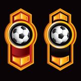 Soccer balls on vertical orange arrows Royalty Free Stock Photos