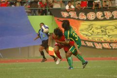 SOCCER BAN. A soccer match between Persis Solo and Persiter Ternate soccer club at Manahan Stadium, Solo, Java, Indonesia.  Indonesian soccer world faces Stock Photos
