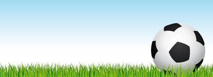 Soccer banner. Football stadium grass and blue sky background. Header with soccer ball in the right side. Royalty Free Stock Images