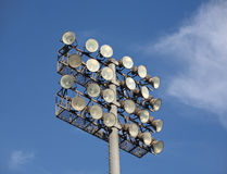 Soccer or Baseball Floodlights. Against a blue sky with wispy white clouds Royalty Free Stock Images