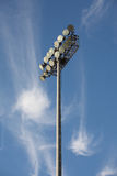 Soccer or Baseball Floodlights. Against a blue sky with strange wispy cirrus cloud formations Stock Image