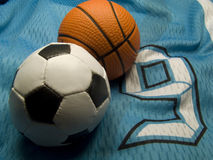 Soccer and basketball bals on the uniform. Soccer and basketball balls on the number nine uniform Royalty Free Stock Image