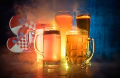Soccer 2018. Single beer glass on table at dark toned foggy background. Support Croatia with beer concept. royalty free stock photography
