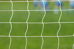 Soccer behind goal net Stock Images