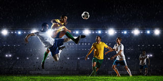 Soccer best moments. Mixed media. Soccer players at sport stadium fighting for ball . Mixed media Stock Photo