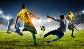 Soccer best moments. Mixed media. Soccer players at sport stadium fighting for ball . Mixed media stock image