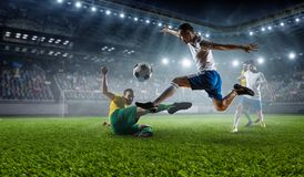 Soccer best moments. Mixed media. Soccer players at sport stadium fighting for ball . Mixed media Royalty Free Stock Photos