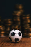 Soccer bet concept with football and money Stock Image