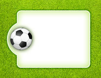 Soccer board. Traditional black white soccer ball with blank white score board for your text on the green grass football field Royalty Free Stock Images