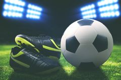 Soccer boot and ball on the field Royalty Free Stock Images