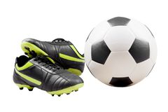 Close up photo of a soccer shoes and ball. Soccer boot and soccer ball isolated over white background. Shot in studio Stock Photos