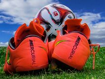 Soccer boots and ball Stock Photography