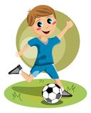 Soccer Boy. Illustration featuring a boy kicking a football ball on a green field. You can find different kids or children playing sports in my portfolio. Eps Royalty Free Stock Photography