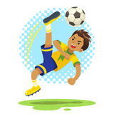 Soccer Boy Hit The Ball Using Bicycle Kick Technique. A soccer boy wearing yellow and blue uniform using bicycle kick technique to hit the ball Stock Photos