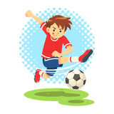 Soccer Boy Shooting The Ball To Make A Goal. Royalty Free Stock Photo