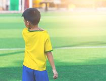 Soccer Boy standing alone on training ground. Soccer Boy is standing alone on training ground stock photography