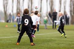 Soccer boys chasing ball Stock Photo