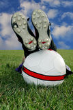Soccer break. Close-up of feet and soccer ball royalty free stock photo