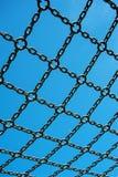 Soccer cage goal, blue sky, net grid imprisoned stock photography