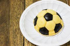 Soccer cake. S on plastic plate Royalty Free Stock Photography