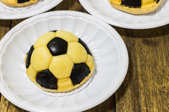 Soccer cakes. On plastic plates Stock Photography