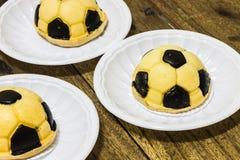 Soccer cakes. On plastic plates Stock Photo