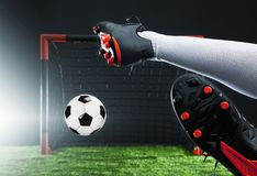 Soccer. Championship concept with soccer player.Striker shooting on goal Stock Photography